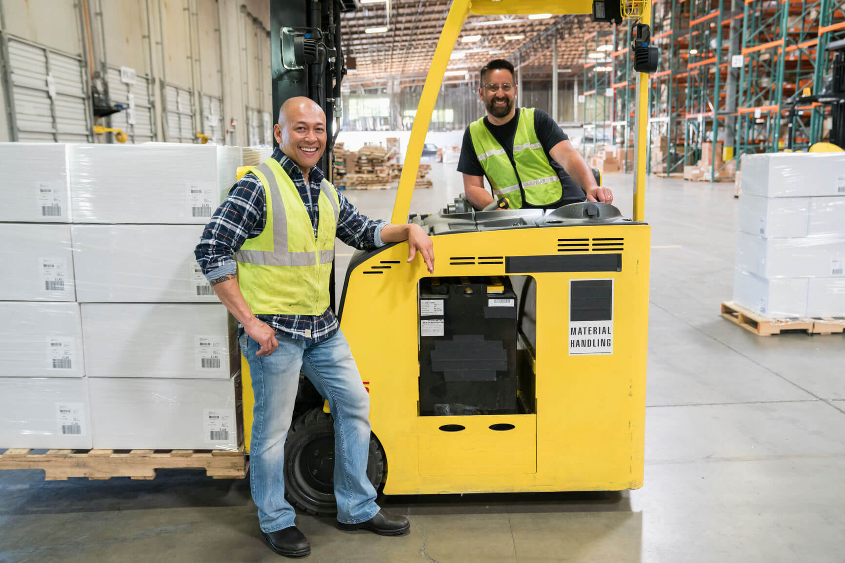 two forklift drivers