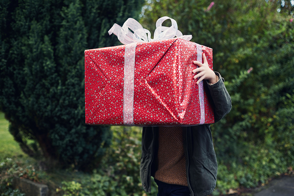 person carrying big gift